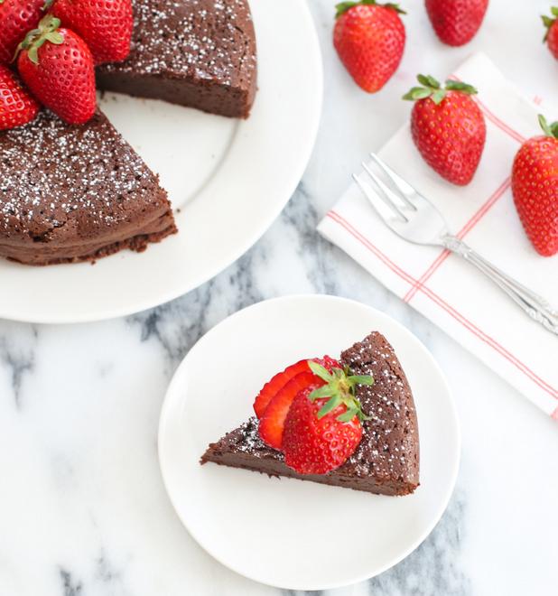 overhead photo of a slice of flourless chocolate cake