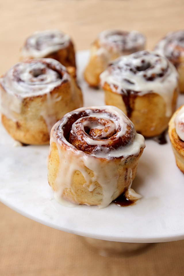 Cinnamon Rolls on a marble cake stand.