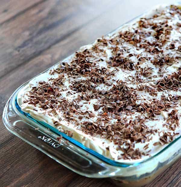 Mudslide Poke Cake - Chocolate cake infused with sweetened condensed milk, hot fudge, vodka, Kahlua and Baileys Irish Cream. An easy, delicious cake with a nice kick! | browneyedbaker.com