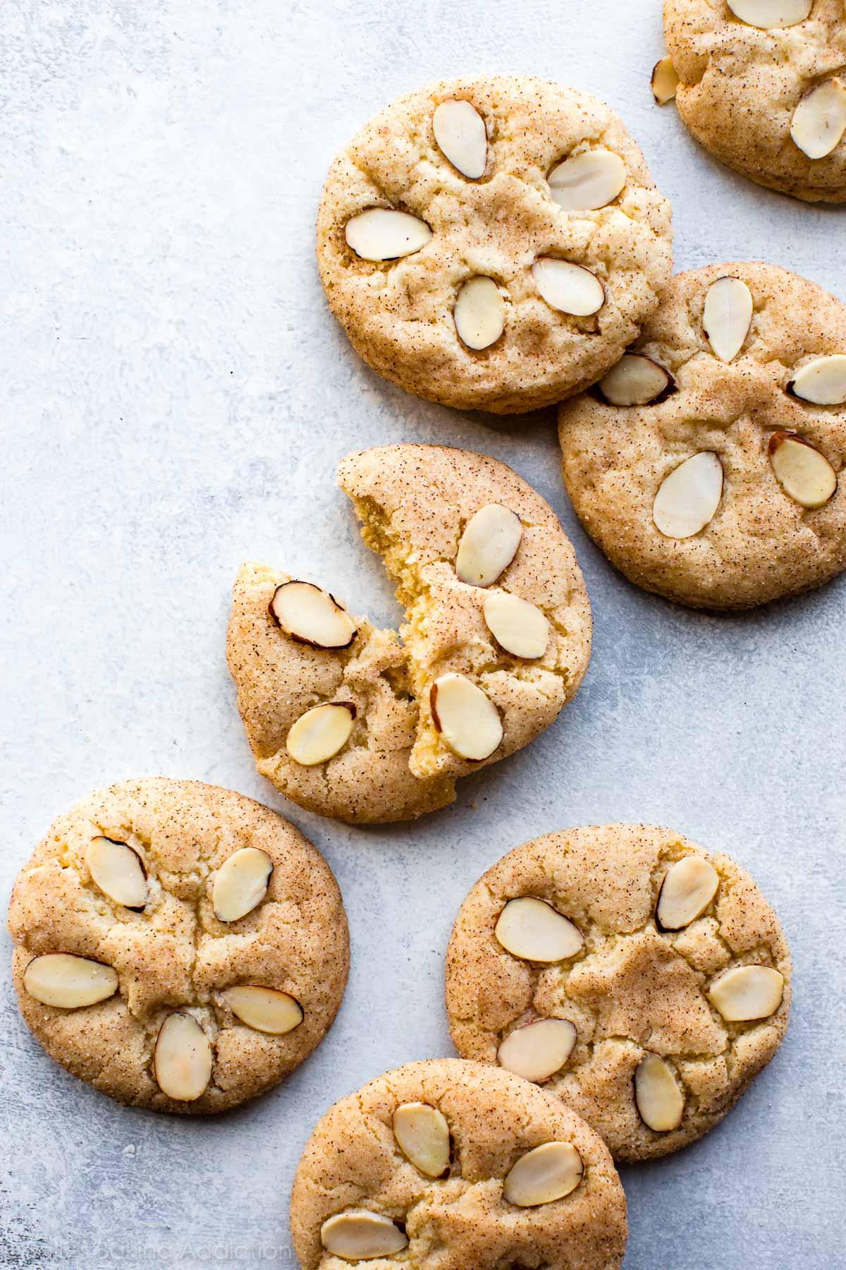 Sweet cinnamon sugar cookies topped with sliced almonds to make adorable little beach sand dollars! Recipe on sallysbakingaddiction.com