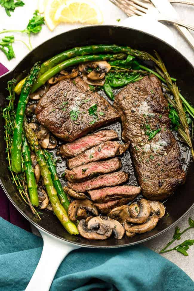 Pan Seared Steak with Garlic, Herb Butter, Asparagus and Mushrooms