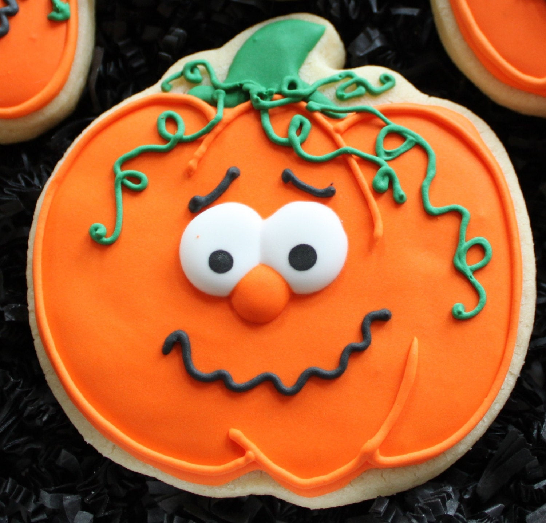 Halloween Themed Cookies  Decorated Pumpkin Cookies Halloween pumpkins Halloween